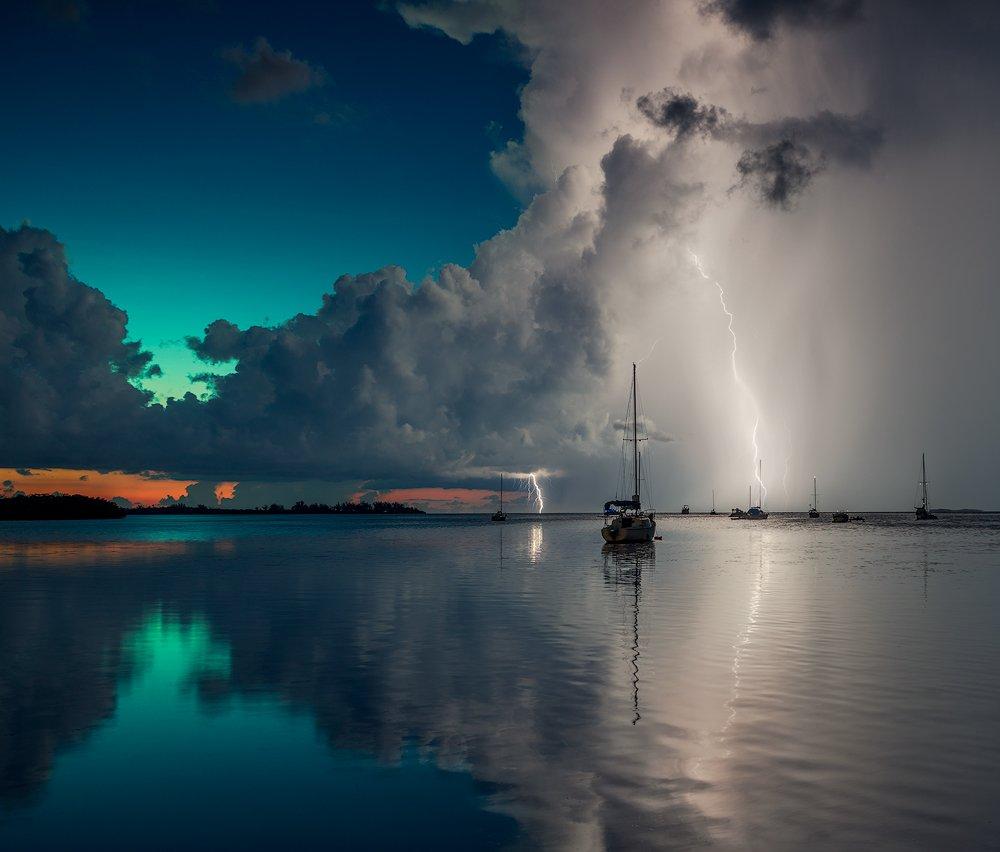 Blue, Boats, Clouds, Lightning, Ocean, Rain, Red, Reflection, Sky, Storm, Summer, Sunset, Water, Alexandr Popovski