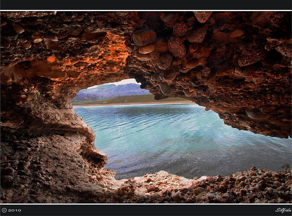 Через пещеру.