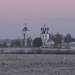 Свято-Успенский Дуниловский женский монастырь на фоне разрушающегося храма Троицы Живоначальной в селе Колбацкое