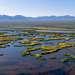 Протяженность реки 1439 километров, из которых 624 - проходят по территории Китая. Река пересекает несколько геологических и климатических зон, впадая в озеро Балхаш.