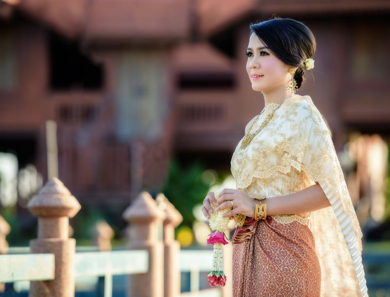 thai; woman; thailand; girl; outdoor; greeting; charming; attractive; ornament; cloth; jewelry; flower; tender; silk; culture; enchantress; buddhist; folk; dance; female; fashion; polite; fabric; portrait; elegant; outfit; nice; tradition; colorful; forma Beautiful Thai girlphoto preview