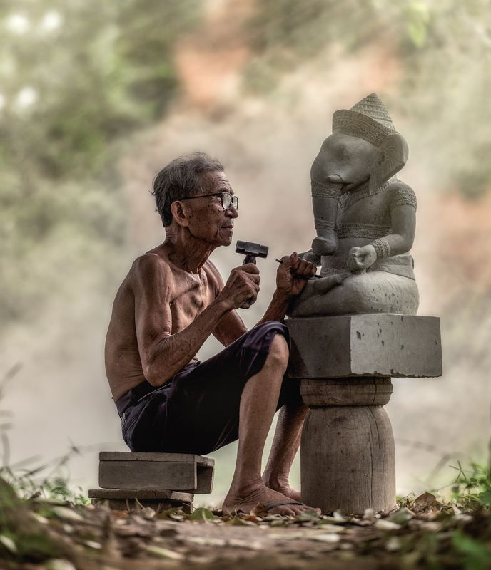 stone; tool; cambodia; chisel; hand; carver; worker; artistic; made; craftsman; decoration; activity; sculpture; oriental; carpentry; craft; construct; carving; sharp; brown; shaving; sand; handmade; chip; skill; traditional; asia; equipment; handwork; pi Stone carverphoto preview