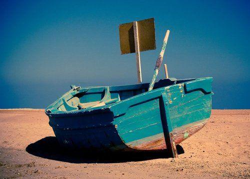 как тащить лодку по песку