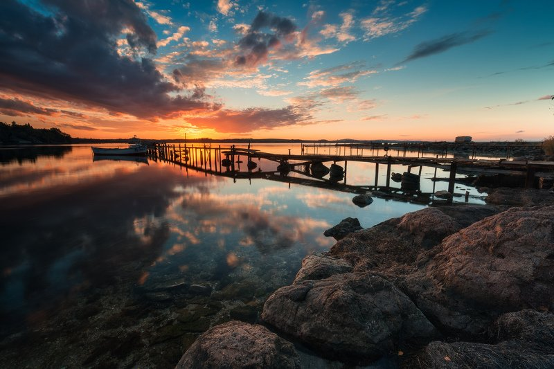 sun, sunset, sea, sky, water, reflection, boat, pier, shore, rocks, clouds, colors, travel, nature, golden hour, Sunset reflectionphoto preview