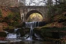 waterfall under the bridge