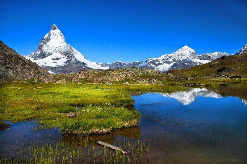 swiss, switzerland, alps, matterhorn, mountains, peak, rocks, lake, grass, green, blue, sky, summer, valais, zermatt Matterhornphoto preview
