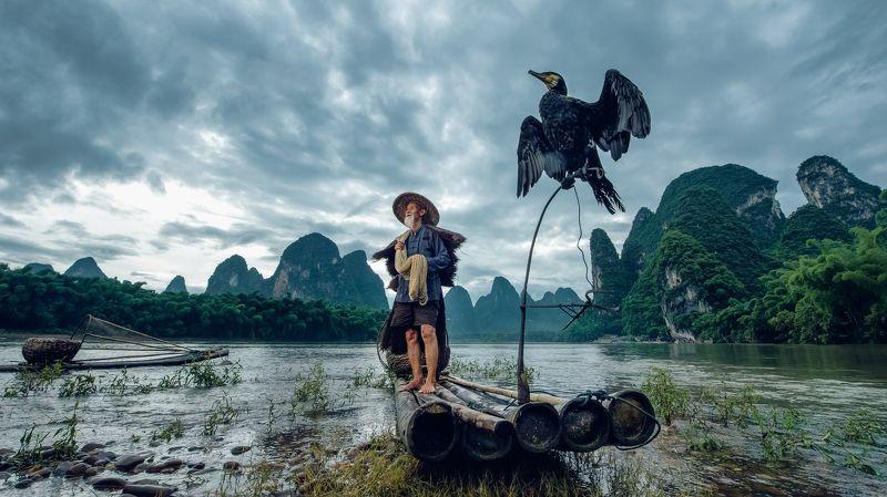 china, guilin,bird,river,mountain,cloud,boat,aisa,asian, Fishermen of Li riverphoto preview