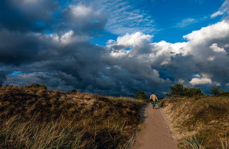sky,clouds,man,road Meet stormphoto preview