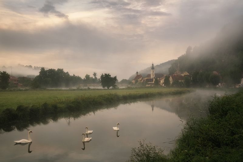 bavaria, birds, bridge, bush, church, church tower, field, fog, foggy, forrest, germany, grass, hill, houses, kallmuenz, kallmünz, meadow, mist, misty, morning, morning fog, mountain, naab, naab valley, picturesque, river, river bank, steeple, swan, swans Morning Idyllphoto preview