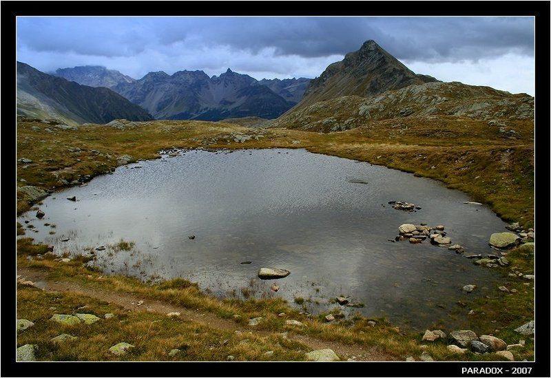 швейцария,перевал бернина,горы,озеро,тревожная тишина,paradox За перевалом - непогодаphoto preview