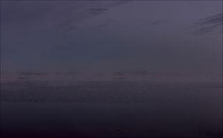 Над озером едва забрезжил рассвет