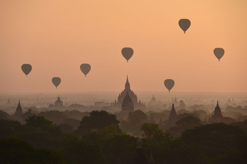 Weather Architecture Bagan Buddhism Built Structure Color Image Flying Fog Horizontal Hot Air Balloon Mid-Air Mode of Transport Mountain Myanmar Nature No People Outdoors Pagoda Photography Silhouette Sky Sunrise - Dawn Temple - Building Transportation Tr Golden Kingdomphoto preview