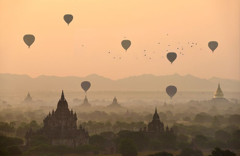 Adventure Ancient Architecture Bagan Built Structure Color Image Dawn Dusk Flying Fog Horizontal Hot Air Balloon Landscape Mandalay Division Mid-Air Myanmar Nature No People Old Ruin On The Move Orange Color Outdoors Photography Religion Scenics Silhouett Balloons over the temples of Baganphoto preview
