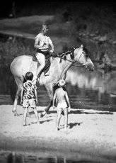купание коня