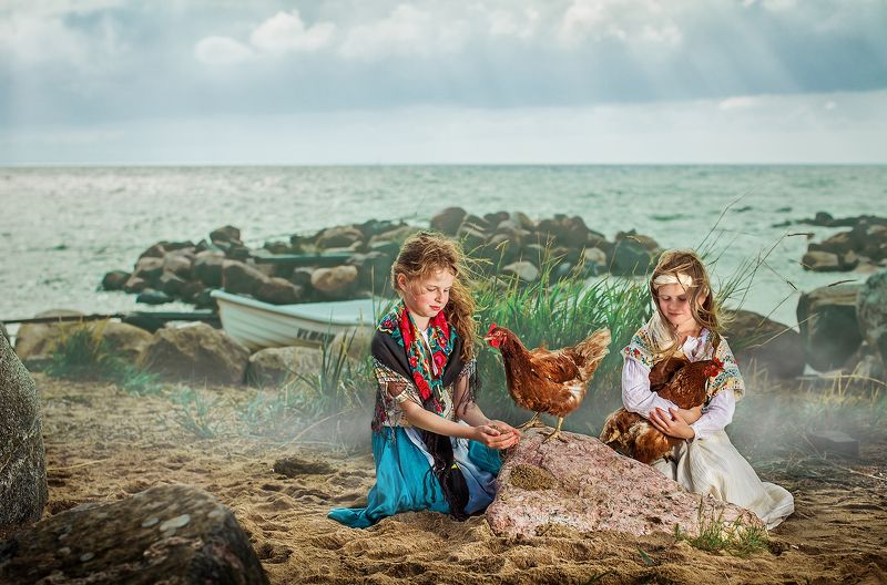 Estonian girls playing with chickens photo preview