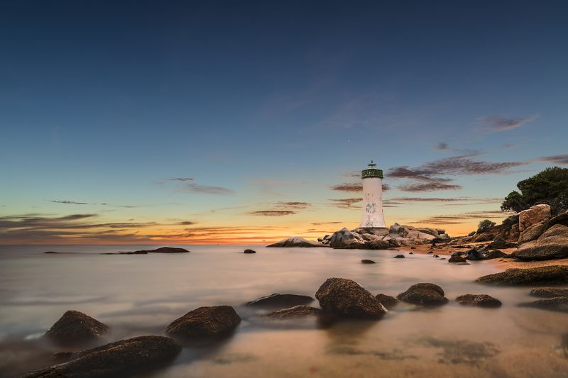 lighthouse,long exposure,surise,stones,sea,sky,zeiss 21mm,nikon d850 lighthousephoto preview