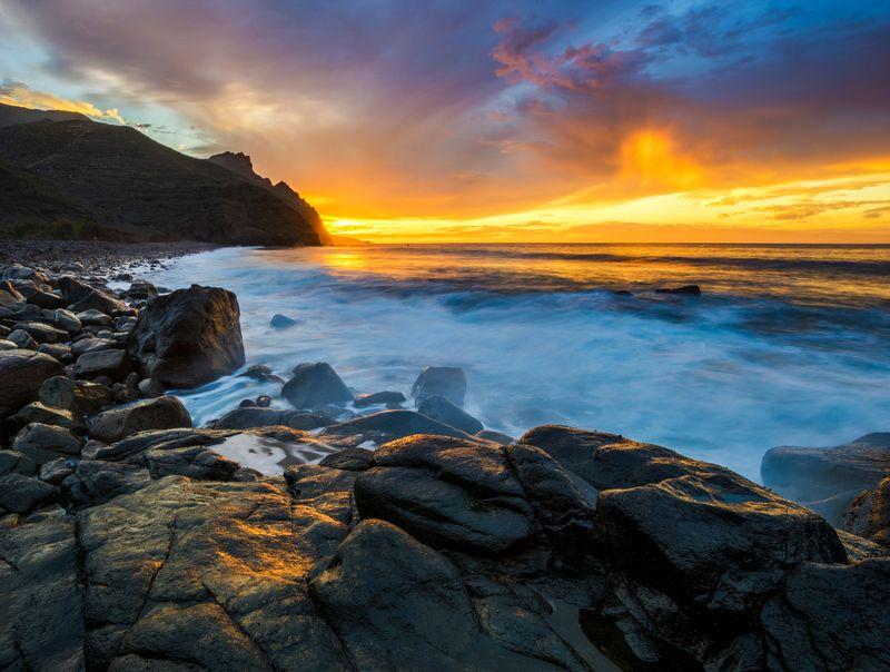 sunset over El Risco beachphoto preview