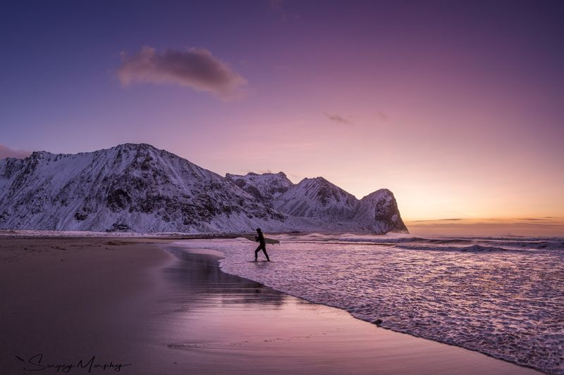 arctic surfer. lofotens. norway. Arctic surfer. Lofotens. Norway.photo preview