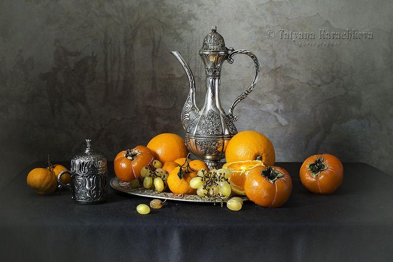 кофейная чашка,  апельсины, мандарины, хурма, кофейник, натюрморт, виноград Натюрморт с турецкой кофейной чашкой и фруктамиphoto preview