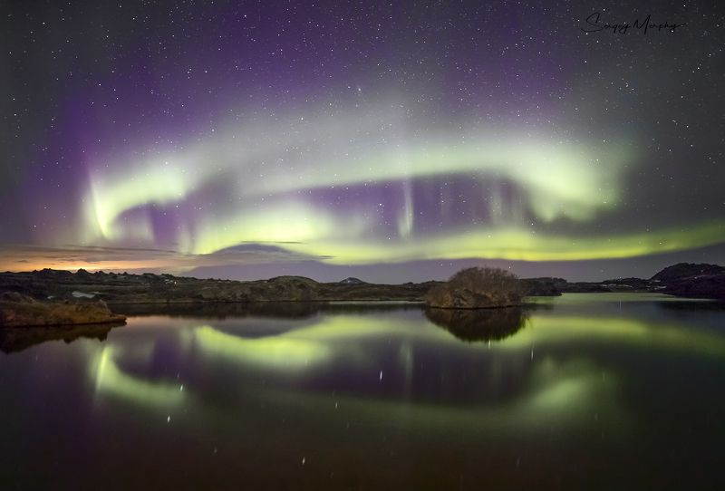 Northern lights over Myvatn lake. Iceland.photo preview