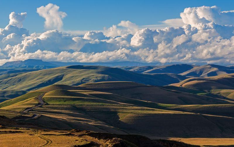 горы, дорога, облака ложится дорога по горным холмам...photo preview