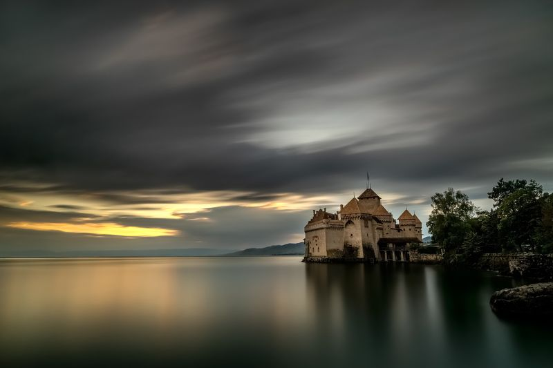 switzerland,chillon castle,long exposure,zeisss,lee filter,nikon d810,sunset,lake,genfersee,stone,tree,dramatic clouds chillon castlephoto preview