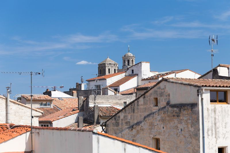 France Roofs city architecture sky cathedral tile old city steps clouds tranquility summer Roofs of Arlesphoto preview