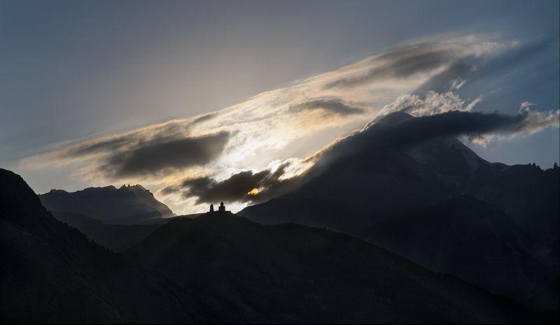holy trinity church, kazbegi, georgia Sunset over the Caucasusphoto preview