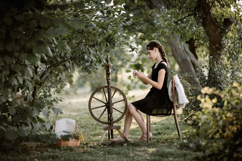 girl spinning wheel young beutiful kornelia bokeh nature trees Girl at a Spinning Wheelphoto preview