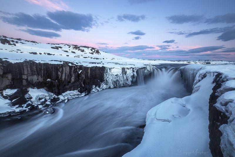 selfoss waterfall iceland sunset Selfoss waterfall at winter time. Iceland.photo preview