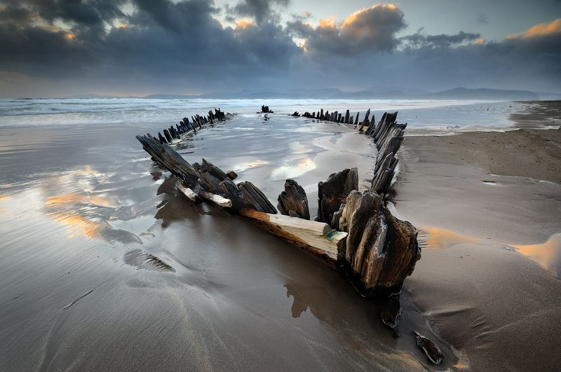 ireland, kerry, rossbeigh, sunset, wreck, boat, ship, beach, iconic, mountains. color, red The Sunbeamphoto preview