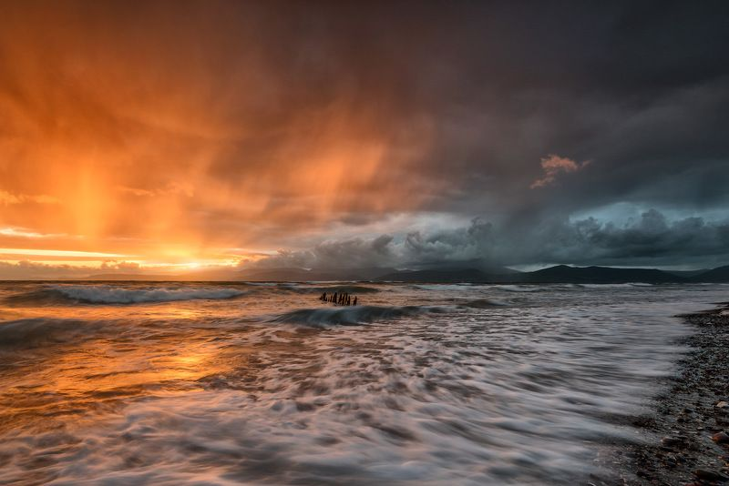 ireland, kerry, rossbeigh, sunset, wreck, boat, ship, beach, iconic, mountains. color, red Stormy Sunsetphoto preview