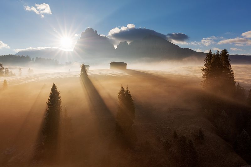 fog, morning, dolomites, peaks, mountains, alps, italy, landscape, mood, atmosphere, sunrise, clouds, trees, sun rays Magic Fogphoto preview